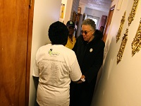 Cook County President Toni Preckwinkle visits the Brewtons after the work was completed on their home.