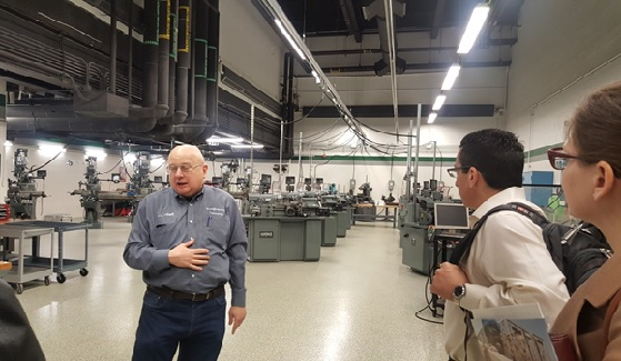 Jim Filipek, Associate Professor and Program Coordinator at the College of DuPage Manufacturing Business and Technology Division, provides participants with a tour of the college's manufacturing technology lab.