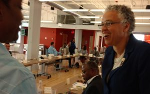 President Preckwinkle greets attendees at On the Table.